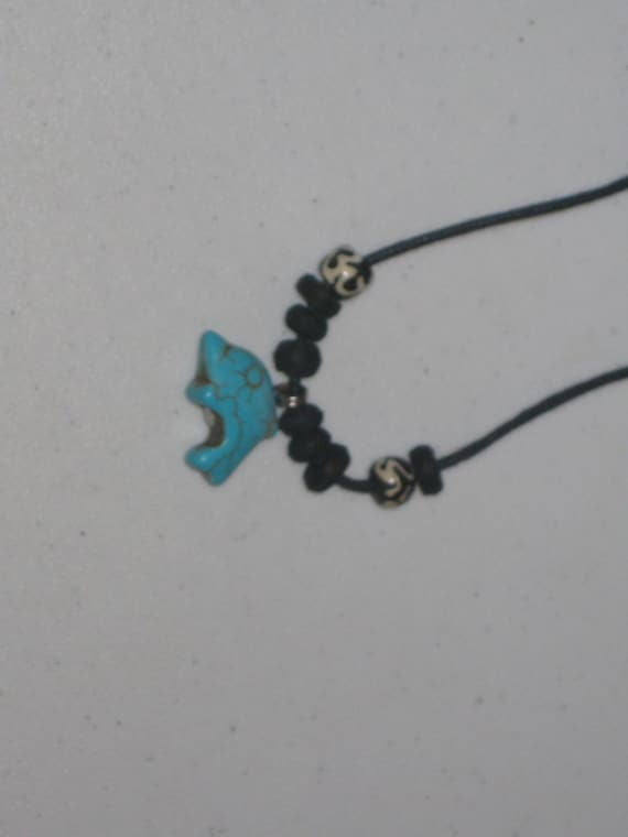 Turquois surfer Dolphin pendant, with adjustable necklace.