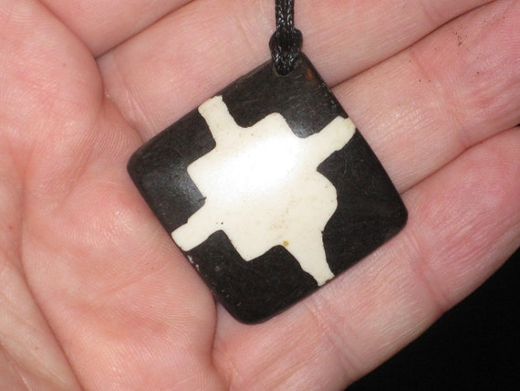 Buffalo bone African tribal, hand carved pendant.