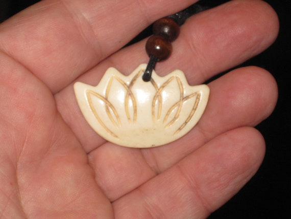 Buffalo bone hand carved lotus blossom pendant.