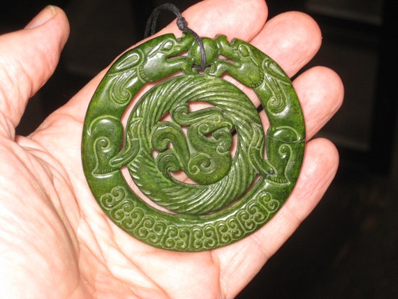 All natural hand carved two sided Jade dragon pendant.