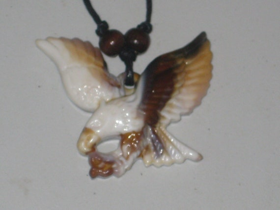 "Surfers bald eagle necklace, adjustable up to 32"" long."