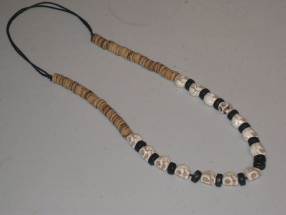 Howlite skulls, & heishi wood  bead necklace, adjustable and hand made.