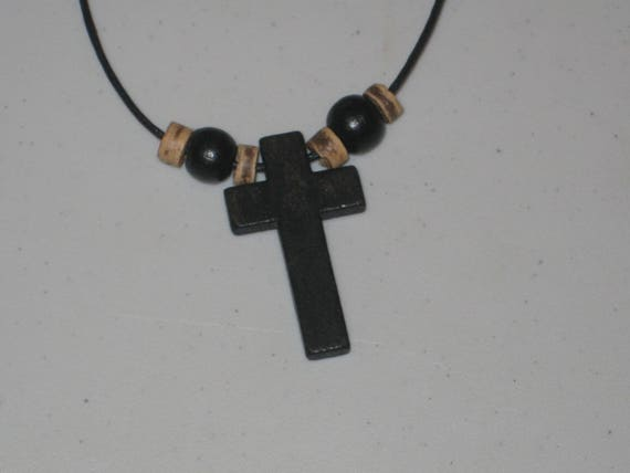 Hand carved cross with heishi wood beads.