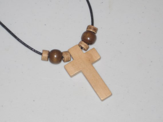 Hand carved cross adjustable necklace with heishi wood beads.
