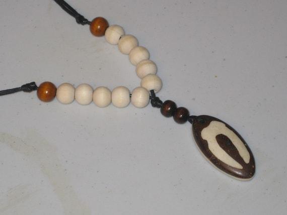 Hand carved African design buffalo bone pendant, adjustable necklace.
