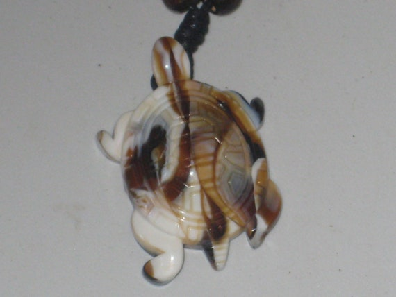 "Surfers Butterscotch turtle necklace, adjustable up to 32"" long."