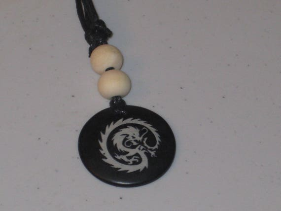 Ox bone pendant and wood beads, with adjustable necklace.