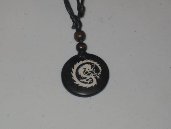 Ox bone dragon pendant with adjustable necklace.
