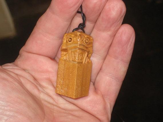 Hand carved rosewood feng shui wealth frog pendant.