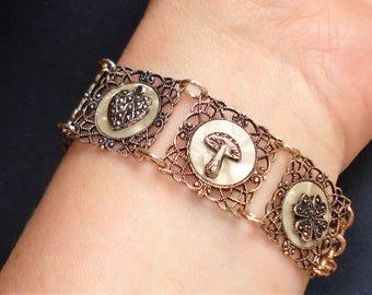 Filigree Panel Charm Bracelet Vintage Gold Tone Eloxal and Lucite Good Luck Symbols