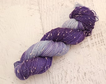 Broken Violet Fingering Weight Sock Yarn (84/16 Superwash Merino/ Cotton Acrylic Donegal Neps) Dyed in Purple & Blue with Pastel Neps- 100 g