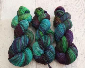 Dark Rainbow Variegated Fingering Weight Sock Yarn (75/25 Superwash Merino/ Nylon) - Hand Dyed in Saturated Purple, Green, & Blue - 100 g
