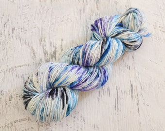 Speckled DK Weight Yarn (100% Superwash Merino) Hand Dyed in Blue, Purple and Black on a White Base - 100 g
