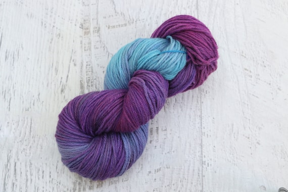 Broken Violet Worsted Weight Yarn (100% Peruvian Highland Wool) with  fuschia, purple, and a bright sky blue