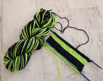 Self Striping Worsted Weight Yarn (100% Peruvian Highland Wool) Hand Dyed in tonal Navy and Neon Yellow/Green - 100 g
