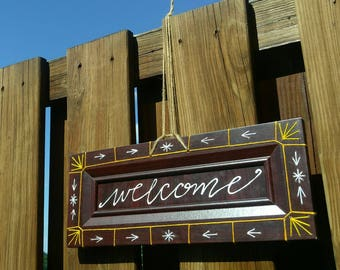 Embroidered reclaimed wood welcome sign, yellow/orange/white geometric pattern