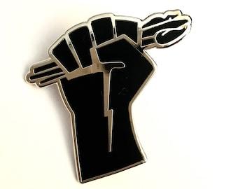 "Artists Unite! Artists Resist! 1.25"" enamel lapel pin"