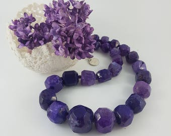 Faceted purple agate gemstone necklace.