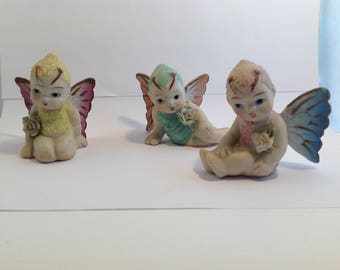 Ever so cute fairies,..all different colours and wings