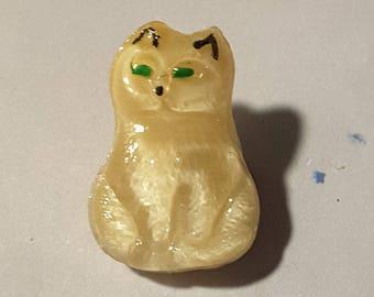 Moon glow glass cat button.