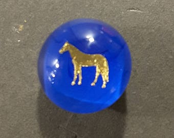Glass paperweight button with intricate gold horse.