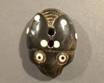 Hand carved Buffalo horn bug button.