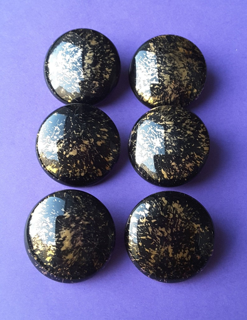 Vintage set of six large black and gold glass buttons.