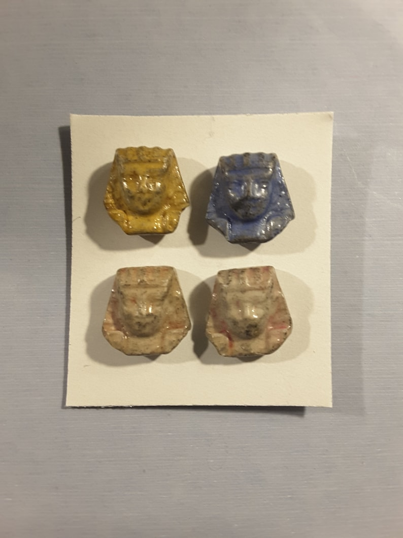Vintage set of 4 pottery hand made Egyptian Sphinx heads.