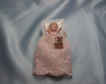Baby girl in a moses basket 1:12