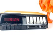 Vintage radio alarm clock orange from the 1970s from Nordmende, tested Strato Clock 171