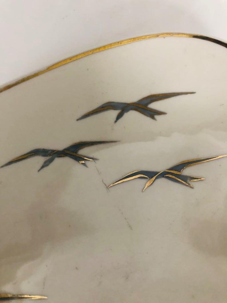 gold rim Vintage bowl in kidney shape swallows