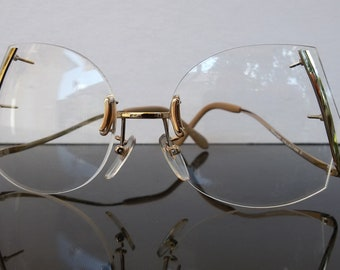 4d375d878e6 Oversize eyeglasses   rimless glasses   drop arm   women fashion   diva  style   gold frame   vintage 1980s eyewear   NOS