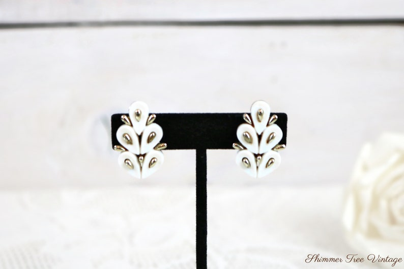 CORO White Thermoset Lucite and silver tone Clip on Earrings