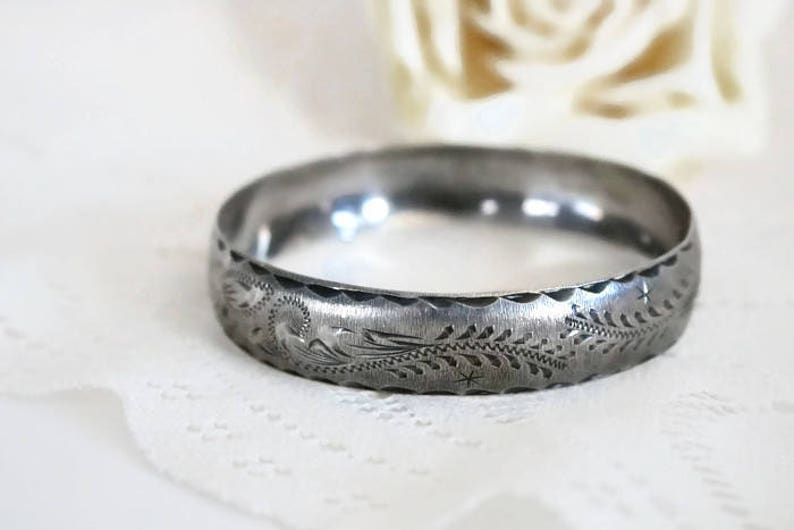 Sterling Silver bangle Bracelet with scrolling feather leaf etching.