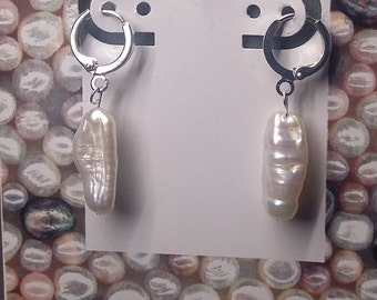 Silver plated earrings with long pearl