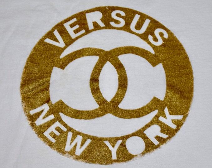 XL * vtg 90s Versus t shirt * indie band teenbeat * 59.172