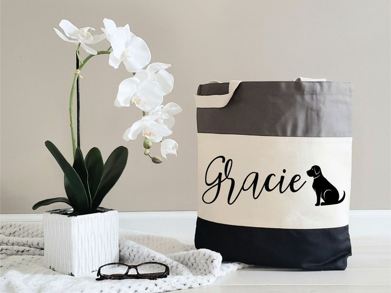 Gifts For A Dog Mom - Black, white and grey custom tote bag with the name Gracie and a black dog printed on the front.