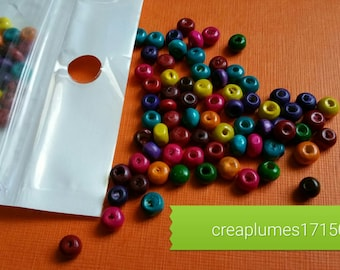Set of 200 multicolored wooden beads, 5.5x4mm