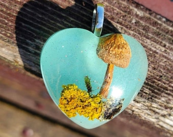 Glow in the dark, Mushroom resting on a Lichen Covered Twig, Resin Pendant