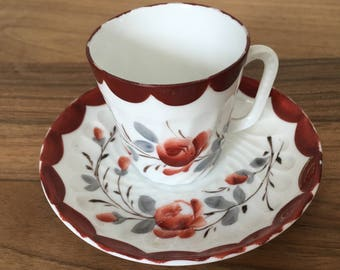 Antique Porcelain Demitasse Coffee Cup and Saucer with Hand Painted Floral Design in Red, Grey, Gold
