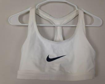 471190d189 White and black nike sports bra top size L