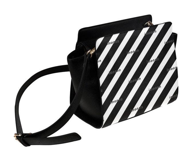 IMOANA stripes shoulder bag.
