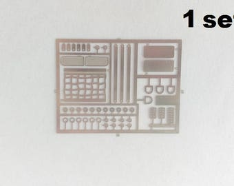 Set of photo-etched hooks, grilles, pedals, IMSA nets and other small parts for racing GT and sports cars 1:43 scale models