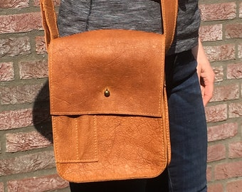 Beautiful handmade shoulder bag with flap in cognac/rust-colored wax leather
