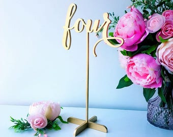12 inches tall Freestanding table numbers. Gold freestanding numbers.