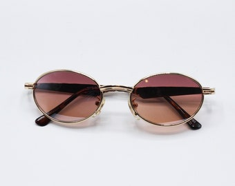 ff9f3464f8 Tinted Oval Round 90 s vintage sunglasses