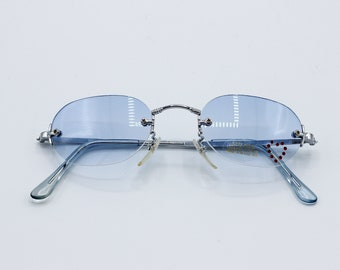 3bfbd6875c16 Tiny Rimless Sunglasses