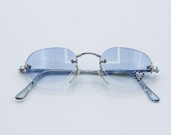 fa3c98bd7c5dc Tiny Rimless Sunglasses