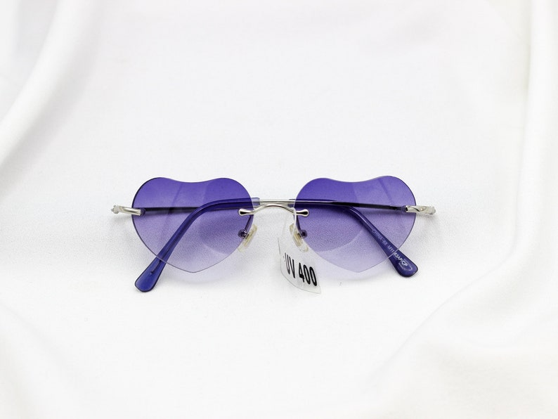 1cbe74b1ad83 Rimless Heart Sunglasses blue purple brown tinted glasses