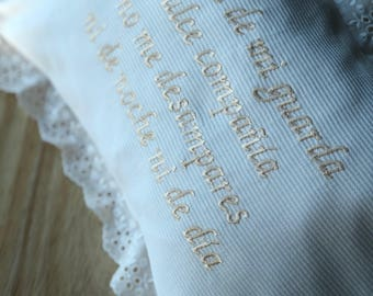 baby pillow with lace and embroidered prayer in spanish